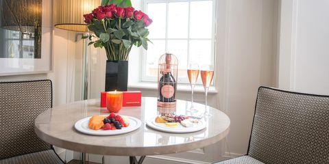 Interior design, Room, Cuisine, Table, Bottle, Furniture, Food, Glass bottle, Dishware, Drink,