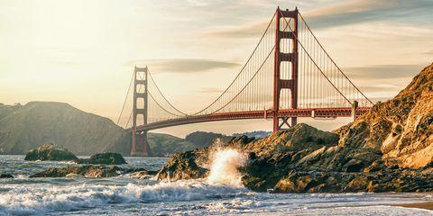 Body of water, Bridge, Sky, Suspension bridge, Cable-stayed bridge, Water, Coastal and oceanic landforms, Coast, Watercourse, Wave,