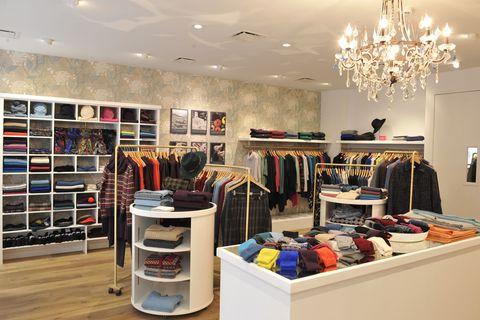 Lighting, Room, Ceiling fixture, Interior design, Light fixture, Ceiling, Chandelier, Interior design, Shelving, Shelf,