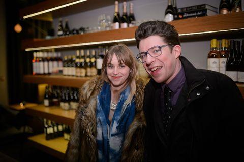 Glasses, Vision care, Smile, Jacket, Shelf, Alcohol, Bottle, Shelving, Drink, Glass bottle,