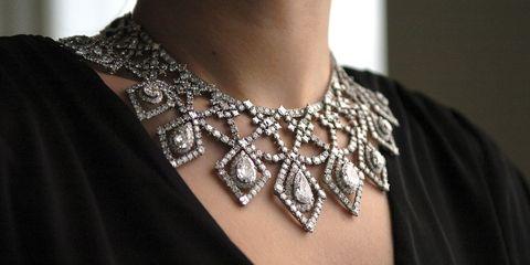 Brown, Fashion accessory, Fashion, Neck, Body jewelry, Natural material, Fashion design, Silver, Chain, Embellishment,