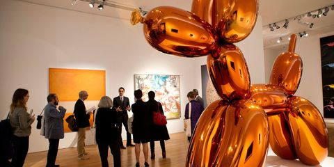 Lighting, Yellow, Human body, Amber, Orange, Exhibition, Art dealer, Luggage and bags, Art gallery, Museum,