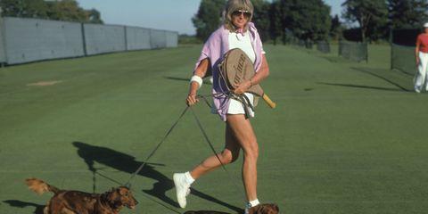 Human, Dog breed, Carnivore, Sports equipment, Leash, Ball game, Tennis racket, Playing sports, Elbow, Dog,