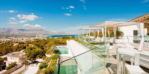 Real estate, Resort, Swimming pool, Apartment, Shade, Villa, Urban design, Outdoor furniture, Seaside resort, Condominium,