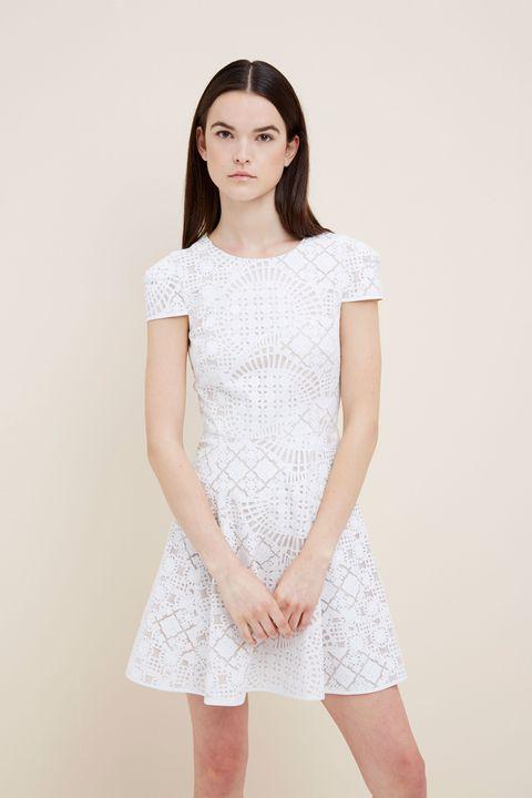 Skin, Sleeve, Shoulder, Standing, Joint, White, One-piece garment, Waist, Elbow, Dress,