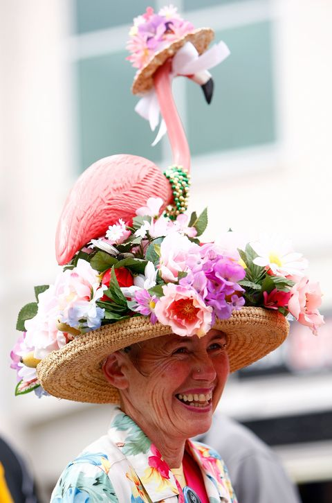 LOUISVILLE, KY - MAY 03:  A race fan stands in the Paddock area durinng the 134th running of the Kentucky Derby on May 3, 2008 at Churchill Downs in Louisville, Kentucky.  (Photo by Jamie Squire/Getty Images)