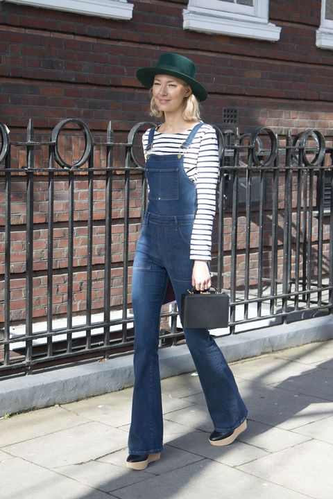 LONDON, ENGLAND - FEBRUARY 23: Founder of Avenue 32 Roberta Benteler wears Frame denim dungerees, Marc Cross bag, Petit Bateau top on February 23, 2015 in London, England.  (Photo by Kirstin Sinclair/Getty Images)
