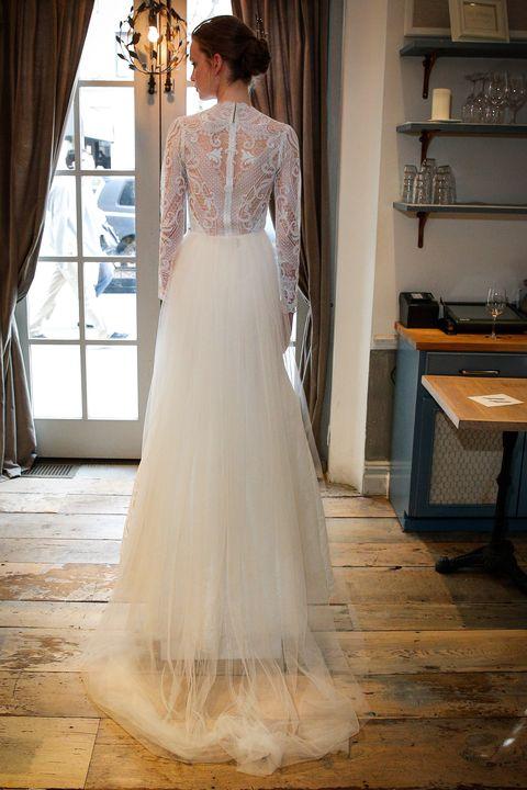 Clothing, Floor, Sleeve, Dress, Bridal clothing, Flooring, Shoulder, Wedding dress, Textile, Photograph,