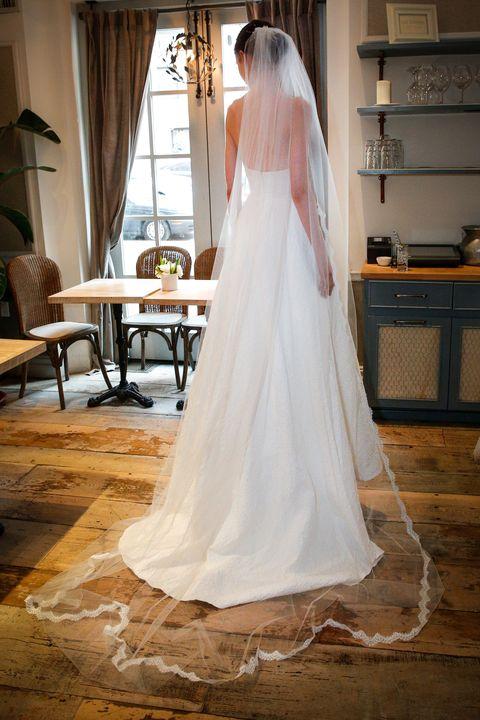 Clothing, Bridal veil, Floor, Veil, Flooring, Bridal clothing, Dress, Textile, Room, Wedding dress,