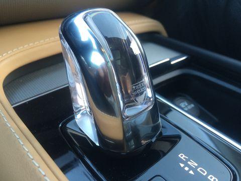Motor vehicle, Automotive design, Logo, Fixture, Gloss, Vehicle door, Luxury vehicle, Symbol, Personal luxury car, Brand,
