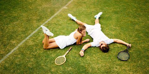 Leg, Sports equipment, Grass, Human leg, Tennis racket, Playing sports, Soft tennis, Knee, Tennis, Athletic shoe,