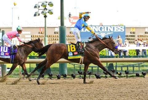 Jockey Victor Espinoza, on American Pharaoh, celebrates his third Kentucky Derby win at the 141st running of the Kentucky Derby.