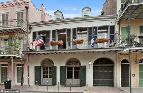 Flag, Facade, Door, Real estate, Flag of the united states, Balcony, Sidewalk, Concrete, Porch, Column,