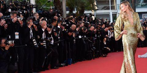Flooring, Carpet, Dress, Gown, Red carpet, Fashion model, Fashion design, Haute couture, One-piece garment, Day dress,