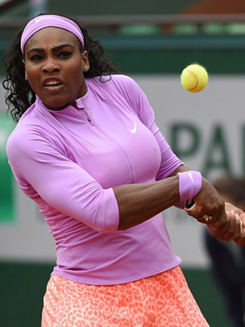 US Serena Williams returns the ball to Czech Republic's Andrea Hlavackova during the women's first round at the Roland Garros 2015 French Tennis Open in Paris on May 26, 2015. AFP PHOTO / PASCAL GUYOT        (Photo credit should read PASCAL GUYOT/AFP/Getty Images)