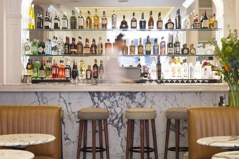 Bottle, Glass bottle, Interior design, Table, Furniture, Drink, Alcohol, Alcoholic beverage, Distilled beverage, Couch,