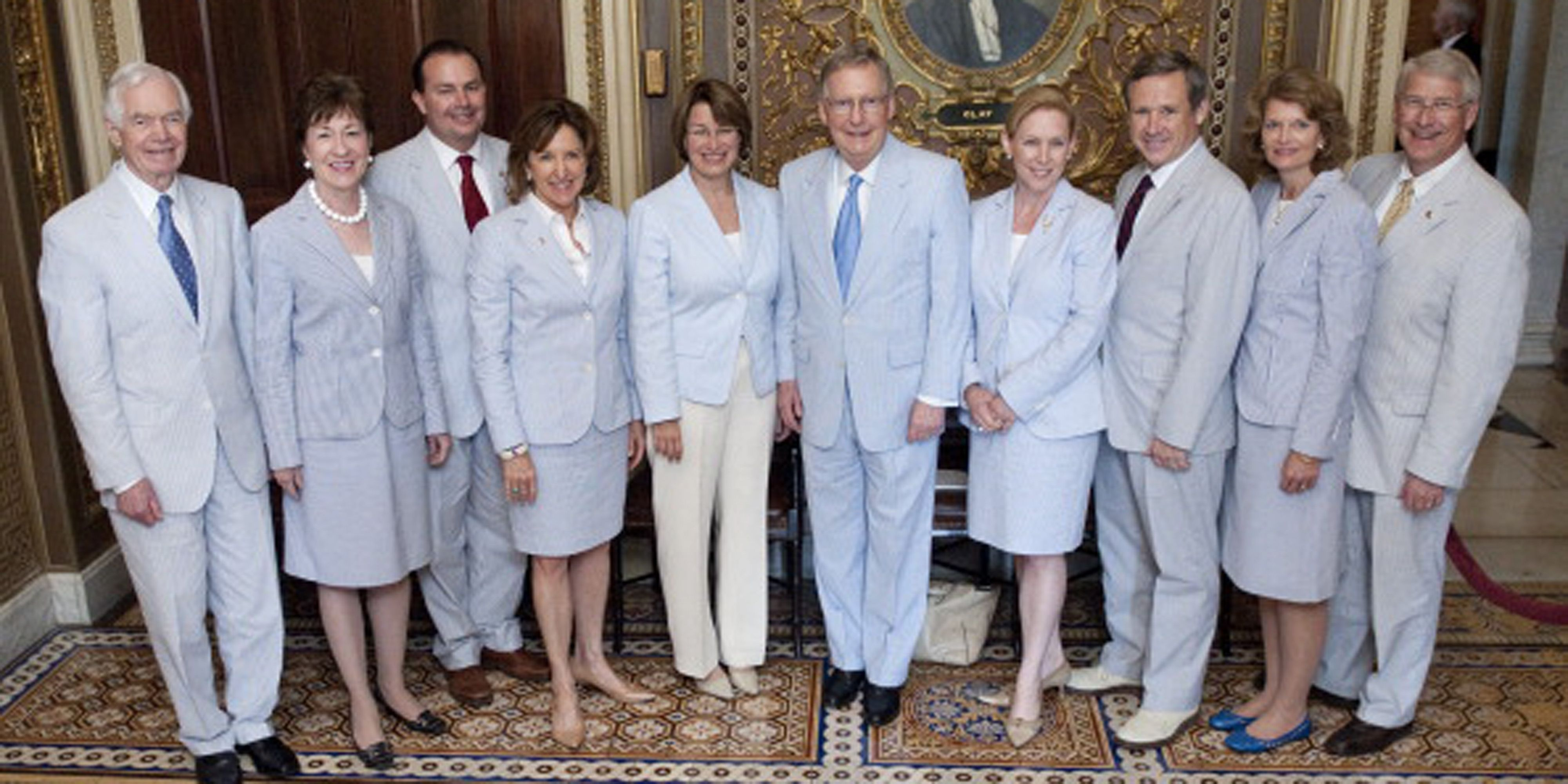 UNITED STATES – JUNE 23: Senators wearing seersucker suits pose for a group photo in the Senate Reception Room in the Capitol on Thursday, June 23, 2011. From left are Senators Thad Cochran, Susan Collins, Mike Lee, Kay Hagan, Amy Klobuchar, Mitch McConnell, Kirsten Gillibrand, Mark Kirk, Lisa Murkowski, and Roger Wicker. The third thursday of June is traditionally called Seersucker Thursday. (Photo By Bill Clark/Roll Call)