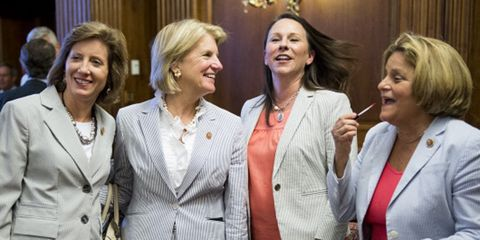 UNITED STATES - JUNE 11: From left, Reps. Vicky Hartzler, R-Mo., Shelley Moore Capito, R-W.Va., Martha Roby, R-Ala., and Ileana Ross-Lehtinen, R-Fla., arrive for the photo-op for the House version of Seersucker Thursday on Wednesday, June 11, 2014. Congress' seersucker day was organized by Rep. Bill Cassidy, R-La. (Photo By Bill Clark/CQ Roll Call)
