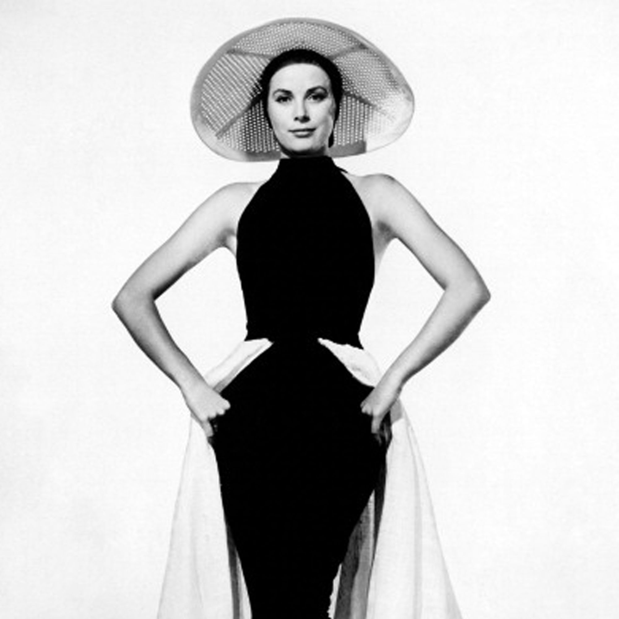 American actress and Princess consort of Monaco Grace Kelly posing wearing a large brim hat and an hip dress on the set of the film To Catch a Thief. USA, 1955. (Photo by Mondadori Portfolio via Getty Images)