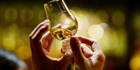 Finger, Glass, Hand, Alcohol, Drink, Amber, Drinkware, Alcoholic beverage, White wine, Distilled beverage,