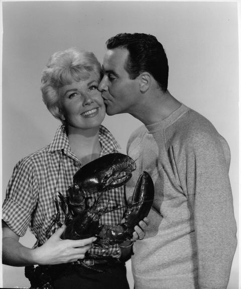 Doris Day is kissed by Jack Lemmon as she holds a lobster in a scene from the film 'It Happened To Jane', 1959. (Photo by Columbia Pictures/Getty Images)