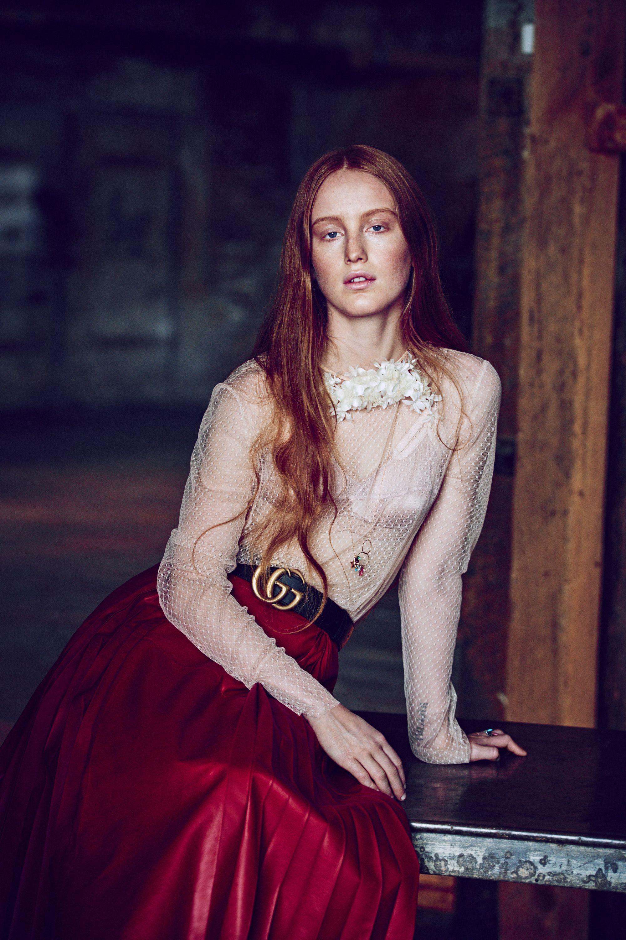 "Whispers of ""Who is that girl?"" were overheard in March at Chanel's New York City reshowing of the Métiers d'Art Collection. The idiosyncratic redhead of interest had seemingly been plucked out of obscurity by the label's It girl scouts to sit alongside Eve Hewson, Dylan Penn, and Lily-Rose Depp. But unlike her front row mates, India Salvor Menuez doesn't hail from a famous family. The 21-year-old was raised in New York's Chinatown by artist parents, whom she credits with showing her ""the possibility and joyous struggle of being your own boss."" And she wasn't overtly clad in Chanel. ""I shop secondhand."" Her reasoning: ""It's better for the planet.""  By 15, Menuez already had a presence on the city's art scene as a co-founder of Luck You, a collective for young creatives. Today the multihyphenate has a hand in every arena of the arts. She generally introduces herself as an artist-cum-actress, but Menuez also counts herself a painter, sculptor, writer, filmmaker, and costume designer. Although she strategically avoids the Hollywood/pop culture spotlight, intellectual hipsters have spotted her in indie films, such as <em>Something in the Air</em>, which premiered at the 2012 Venice Film Festival, and guerrilla-style performance art pieces; her feminist group show ""Milk and Night"" drew crowds at last year's Miami Art Basel. Widespread recognition may be unavoidable: Pharrell cast her as a model for the cover of his <em>Girl</em> album, and critics are comparing her controversial character in the upcoming indie film <em>White Girl</em> to Chloë Sevigny's 1995 breakout role in <em>Kids</em>. And, of course, there is that Chanel front row."
