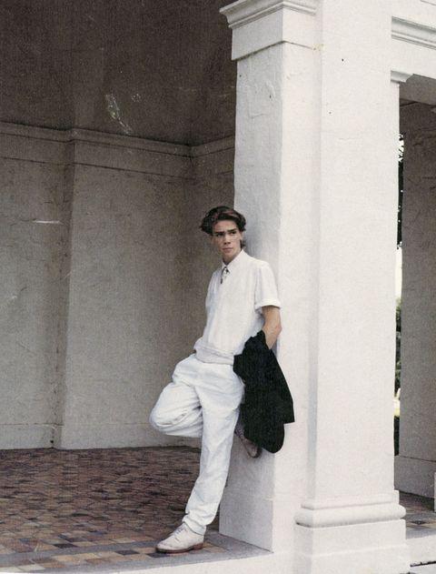 Sleeve, Shoe, Shirt, Standing, Wall, Cap, Street fashion, Knee, Bag, Column,