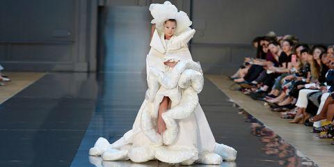 Fashion, Costume design, Fur, Performance art, Costume, Fashion design, Foot, Drama, Sculpture, Fashion model,