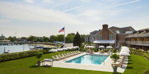 Swimming pool, Flag, Real estate, Resort, Villa, Water feature, Lawn, Garden, Outdoor furniture, Yard,