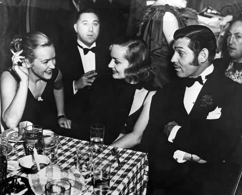 Clark Gable and Carole Lombard dining out