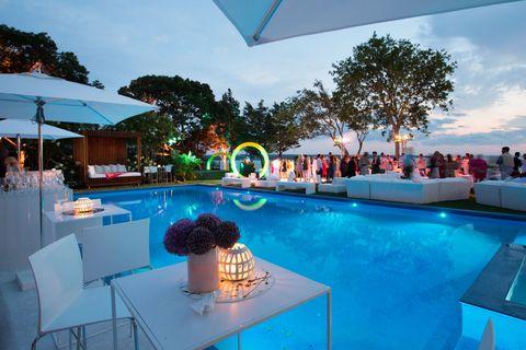 Swimming pool, Resort, Real estate, Shade, Azure, Umbrella, Resort town, Hotel, Outdoor furniture, Villa,