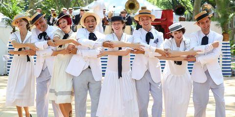 Event, Tree, Hat, Headgear, Tradition, Uniform, Costume accessory, Team, Sun hat, Suit trousers,