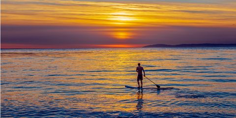 Surfboard, Surfing Equipment, Stand up paddle surfing, Sunrise, Sunset, People in nature, Amber, Surface water sports, Red sky at morning, Dusk,