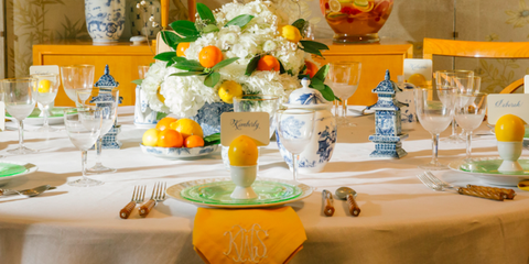 Tablecloth, Yellow, Room, Serveware, Table, Dishware, Stemware, Furniture, Bouquet, Orange,