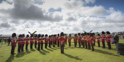 Cloud, Musician, Musical ensemble, Uniform, Parade, Team, Cumulus, Marching, Wind instrument, Military organization,