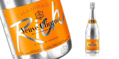 Product, Liquid, Bottle, Orange, Glass bottle, Line, Amber, Logo, Label, Packaging and labeling,