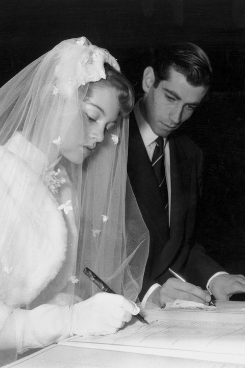 <p>With Roger Vadim, signing the marriage register during their wedding at a church in Paris on December 20, 1952. </p>