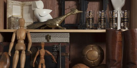 Brown, Art, Sculpture, Boot, Liver, Collection, Leather, Riding boot, Shelving, Bronze,