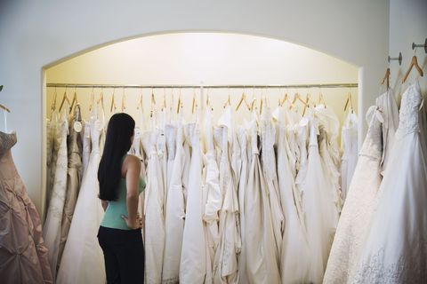Textile, Clothes hanger, Fashion, Waist, Fashion design, Boutique, Collection, One-piece garment, Wedding dress, Day dress,