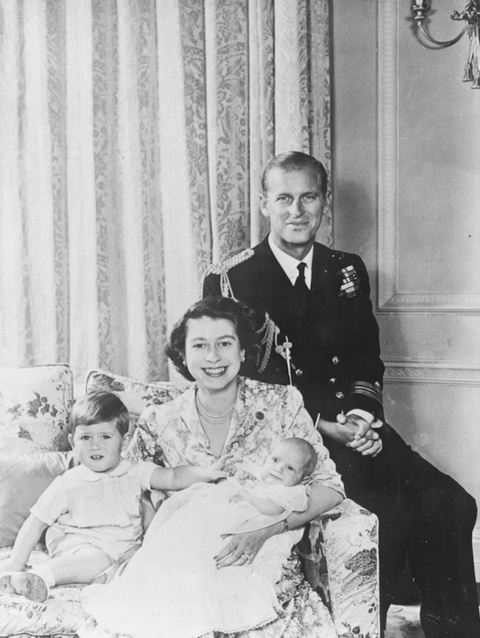 <p>Two years later, it was Princess Anne's turn to sit still and take christening photos with mama and papa bear. Does anyone else thinking Prince Charles is trying to give his sis the bunny ears in this?</p>