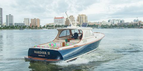 Watercraft, Transport, Boat, Waterway, Speedboat, Tower block, Naval architecture, Cityscape, Boating, Ship,
