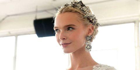 Ear, Hairstyle, Chin, Bridal accessory, Forehead, Eyebrow, Eyelash, Earrings, Style, Hair accessory,