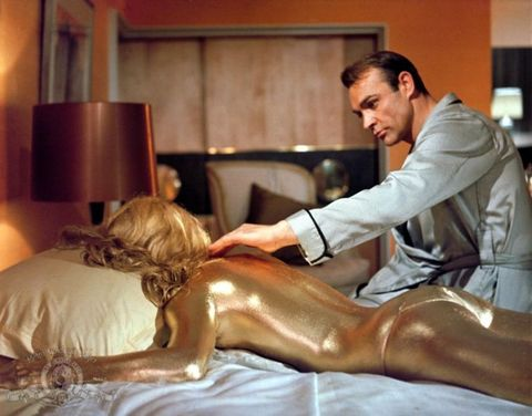 """<p>English actress Shirley Eaton played Jill Masterson, who was killed by Auric Goldfinger himself after painting her body gold caused her to die of skin suffocation (which isn't a real thing). Unfortunately, it's considered one of the <a href=""""http://www.theguardian.com/film/2007/jul/27/jamesbond.actionandadventure"""" target=""""_blank"""">most sexist scenes in cinema history</a>.</p>"""