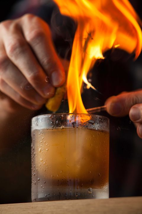 Flame, Drink, Alcohol, Fire, Heat, Hand, Old fashioned, Boilermaker, Distilled beverage, Glass,