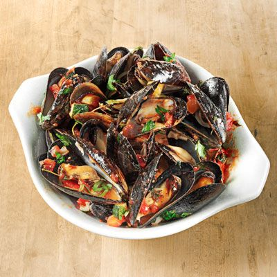 """<p>Chef-owner Marc Murphy of Ditch Plains in New York City adds a colorful French twist to his basic steamed mussels recipe.</p> <p><strong>Recipe:</strong> <a href=""""../../../recipefinder/provencal-mussels-recipe-opr0612"""" target=""""_blank""""><strong>Proven&#231al Mussels</strong></a></p>"""