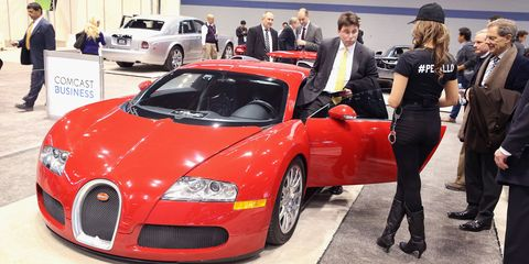 Tire, Automotive design, Vehicle, Land vehicle, Event, Car, Personal luxury car, Performance car, Hat, Bugatti,