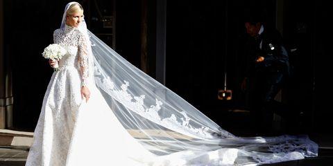 Textile, Dress, Veil, Bridal veil, Bridal clothing, Gown, Formal wear, Wedding dress, Fashion, Bridal accessory,
