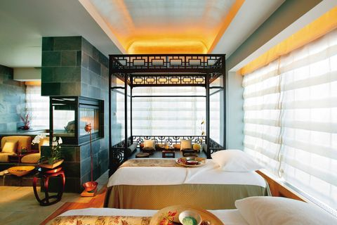 "<p><strong>Where:</strong> <a href=""http://www.mandarinoriental.com/newyork/luxury-spa/"" target=""_blank"">Mandarin Oriental New York</a></p><p><strong>Spa Highlights: </strong><strong></strong>The luxe spa oasis at the Mandarin Oriental may have the bustling New York City skyline as its backdrop, but inside it's the ultimate serene escape. Guests are encouraged to arrive 45 minutes prior to their spa appointment in order to take advantage of the Oriental Tea Lounge, where you can prep for your treatment with an herbal infusion or unwind in the heat and water facilities. The Asian-influenced sanctuary offers services inspired by the Far East, from a Thai Yoga Massage to chakra balancing treatments and an Oriental Harmony guided treatment. Take your spa day to the next level by going for the VIP Spa Suite—a private spa that boasts its own fireplace, steam room, bathtub, kang relaxation bed and couples massage beds. </p>"