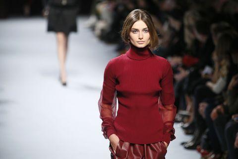 Sleeve, Human body, Shoulder, Fashion show, Joint, Waist, Red, Fashion model, Style, Street fashion,