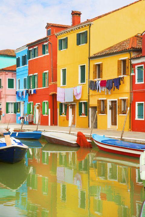 Body of water, Blue, Window, Reflection, Waterway, Watercraft, Water, Neighbourhood, Red, Boat,